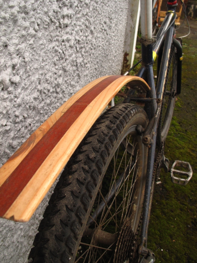 Laminated wood mud guards